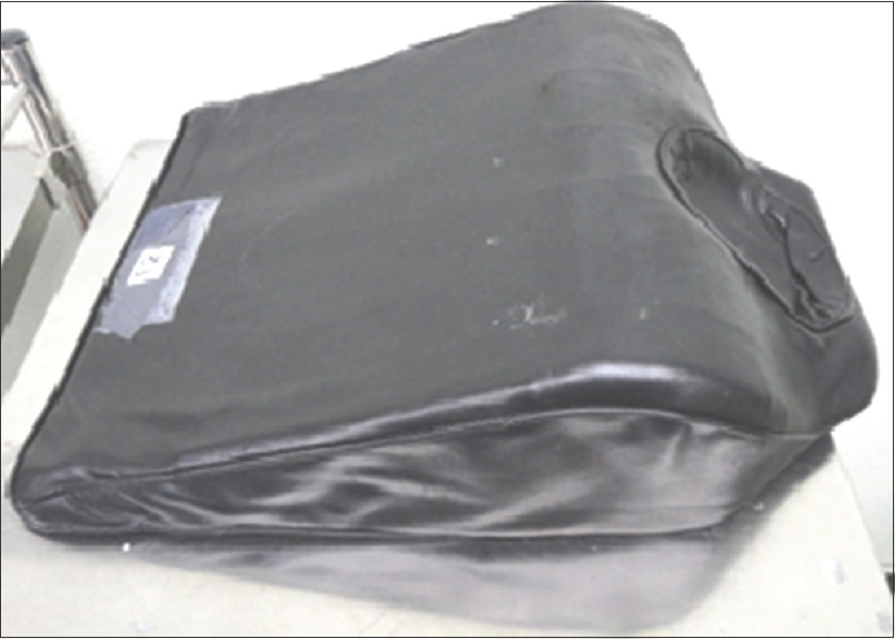 Figure 2: Q-Pillow, a customised tapered sandbag placed under patient's shoulders which aids in optimal neck extension and head support